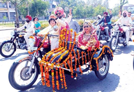 The Wedding Procession on a Bike
