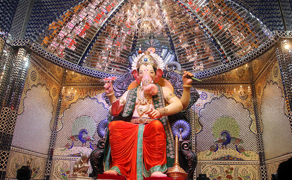 Lalbaugcha Raja stands tall: This 80 plus year old Ganpati pandal in Mumbai's Lalbaug attracts massive crowds each year. Devotees wait for hours and sometimes days in queues to get a glimpse of their beloved god. (Image: Firstpost.com)
