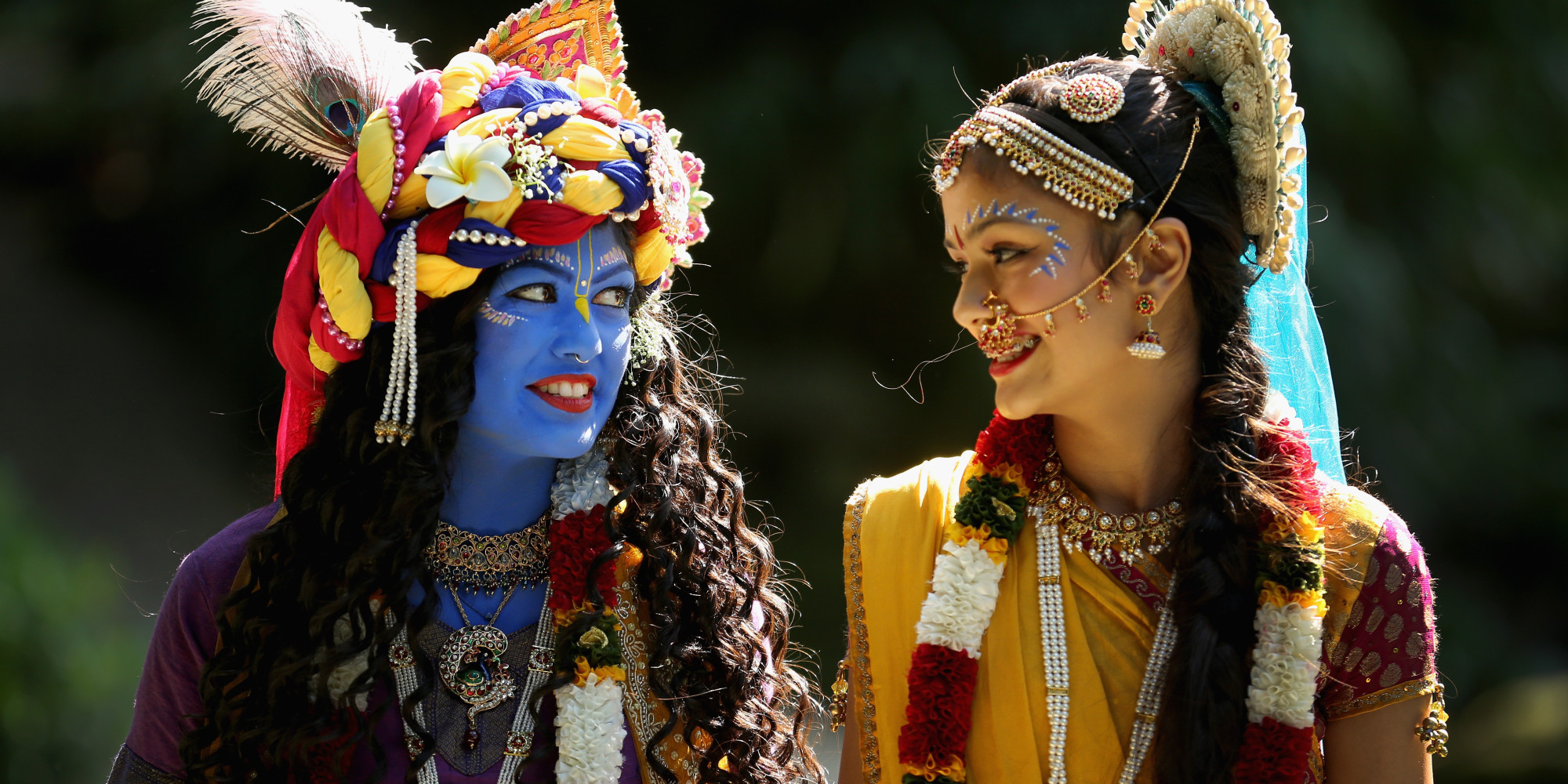 Devotees dressed as Krishna and Radha during Janmashtmi celebrations at the George Harrison Memorial Garden, Watford, England in 2013.