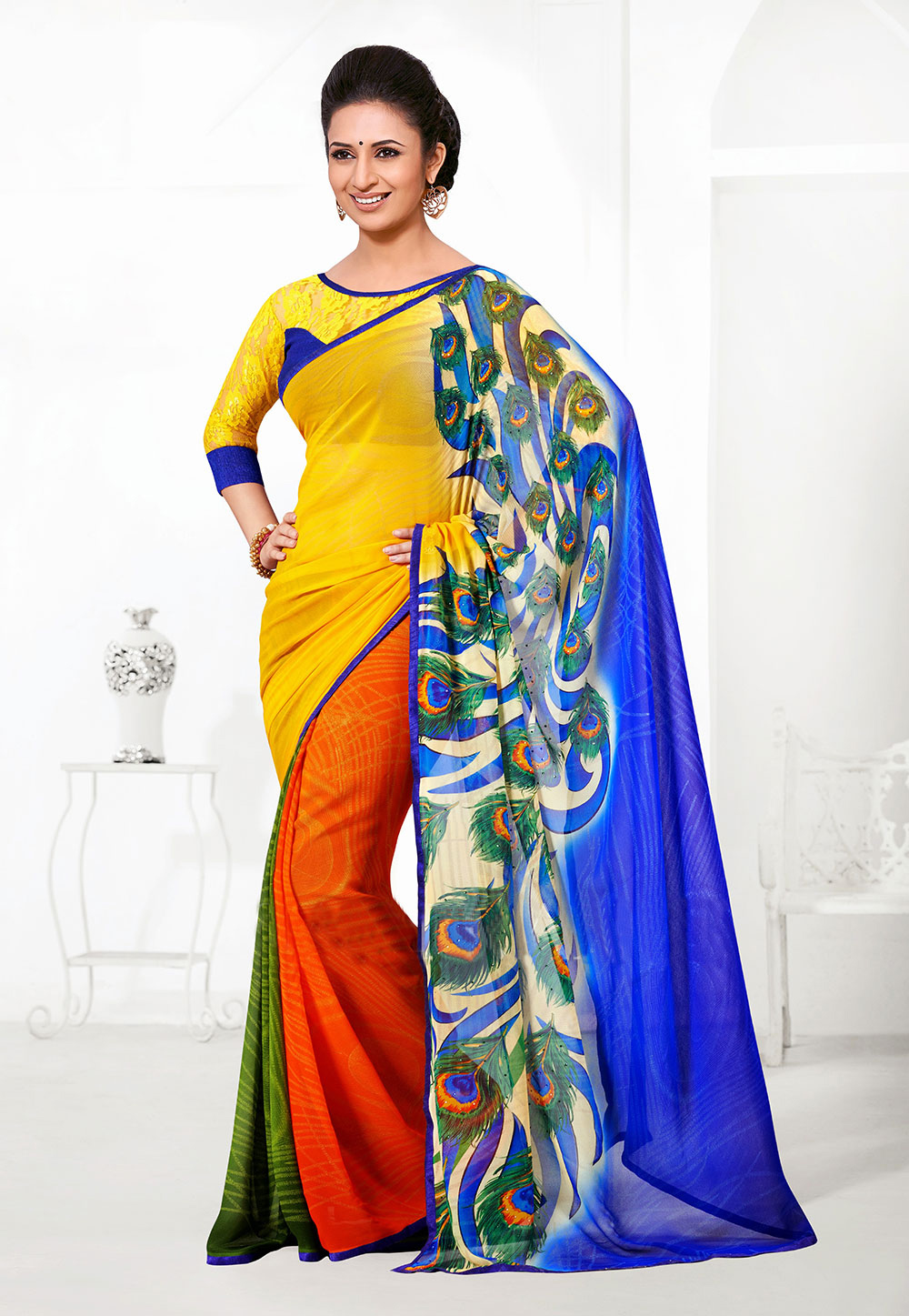 A Peacock print saree in Yellow, Orange, Green and Blue. (Image: Utsavfashion.com)