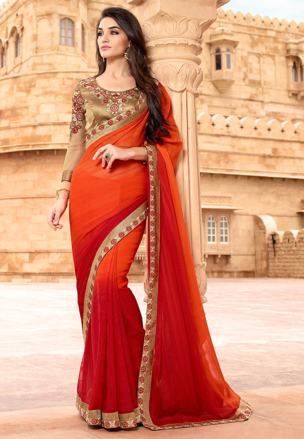 A shaded orange and red faux chiffon jacquard saree. (Image: Utsavfashion.com)