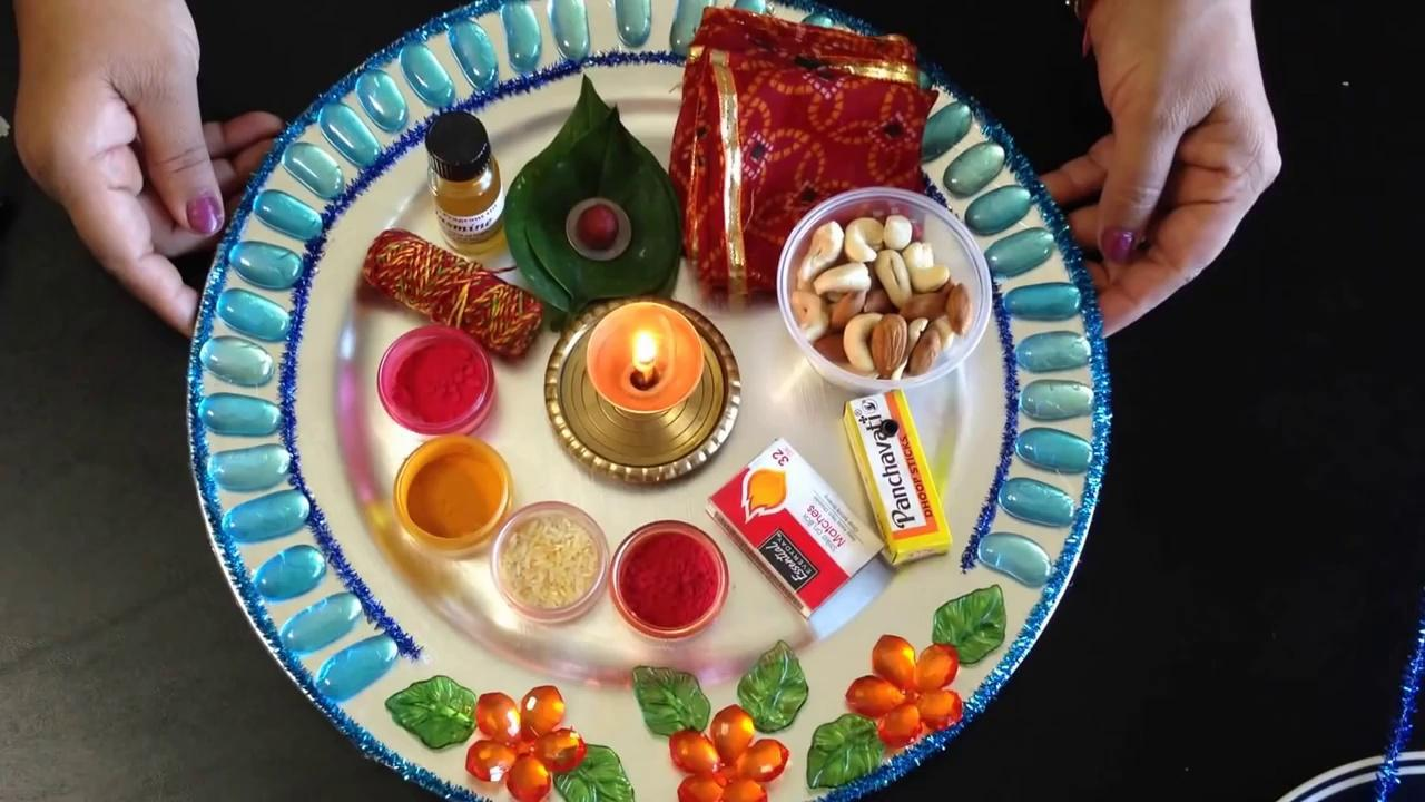 Navratri day 8 the day of goddess mahagauri utsavpedia for Aarti thali decoration with rice